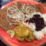 Bistec empalizado with white rice, black beans and tostones