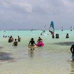 Dozens of wind surfers off shore