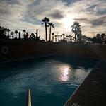 Pool Reflecting Sun at Dusk