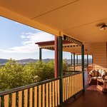 Our sweeping verandah with stunning vineyard & Mudgee Valley views