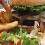 Back bacon provolone cheese burger with sauteed onions & mushrooms