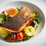 Pan fried salmon with artichoked, green beans, anchovies and duck egg
