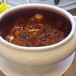 Императорский острый суп с телятиной, фун- чозой и перепелиным яйцом