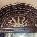 Carved image of Lord Krishna on Kaliya Mardan Snake carved on the door