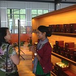 Sales people help customers select tea