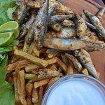 Crispy sardines with fries, lemon and garlic