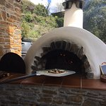 Nola learns to cook in a wood oven