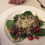Sliced fillet of beef with tomato and spinach