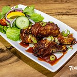 BBQ Chicken Wings served with a salad garnish