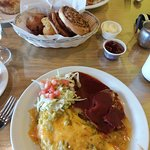 Omelet with green chile and cheese, potatoes with red chile