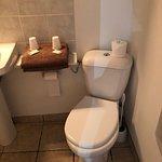 Small bathroom has everything necessary.