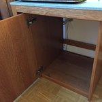 Empty cabinet, no minibar nor refrigerator