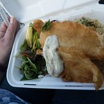 Tempura battered haddock with salad and couscous.