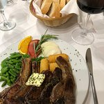 Delicious grilled lamb cutlets with croquettes and green beans
