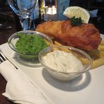 Fish and chips complete with mushy peas. Delicious