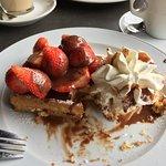 Waffles, Strawberries, Cream and chocolate sauce