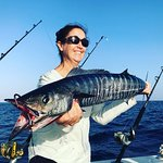 This happy lady caught her wahoo!