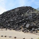 pile of rocks with a lot of petroglyphs