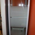 Shower stall view opposite of toilet room 413