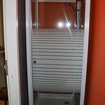Shower stall opposite toilet