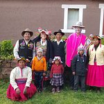 Dressing up in traditional clothes with our host family in Llachon