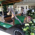 a vintage vehicle just outside the main entrance