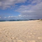 Beautiful clean white sands and rolling waves at Tugan Beach
