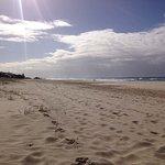 Long white sand beaches at Tugan Beach