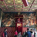 Look closely at the tapestries behind the throne to see the unicorns