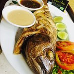Grilled Full Fish with lime and butter sauce + garlic sauce + french fries potatoes + mixed sala