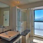 Seaside Deluxe Suite has modern showerroom with spectacular sea views