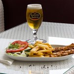 Mini skewer with chips and salad. Draft beer, Estrella Galicia! Best beer on Mallorca!