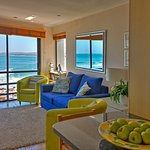 The Seaside Luxury Apartment lounge with comfortable sofa has amazing views onto the waves