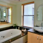 Seaview Luxury Suite has a deluxe bathroom with spa bath and modern shower