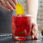Strawberry Hibiscus Caipirinha: Hibiscus-infused Cachaça, muddled strawberries, lime