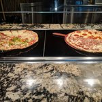 No buffet is complete without pizza.
