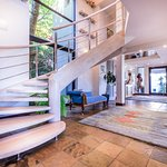 The elegant reception area leads to the sunny pool deck, while a stylish staircase leads to suit