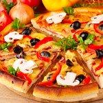 Vegetarian Pizza with Zucchini, onion, eggplant and tomato