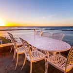 Spectacular sunsets from Seaside Penthouse balcony just over the waves
