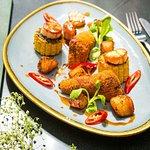 Pan-fried king scallops, panko ox cheek, spiced potatoes, charred sweetcorn, beef jus