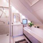 Seaside Penthouse main bedroom bathroom has bath sunk in caesarstone