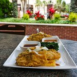 Fish & Grits: Triggerfish (grilled, blackened or fried) served over cheddar grit cake