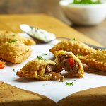 Bar Fogo Brazilian Empanadas: Flaky pastry stuffed with Picanha, onions, peppers, chimichurri ai
