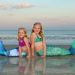 Sisters enjoying a mermaid photoshoot on Hilton Head Island
