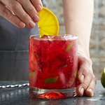 Strawberry Hibiscus Caipirinha: Hibiscus-infused Cachaça, muddled strawberries, lime