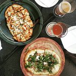 Flatbread pizzas and beer on the patio