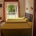 Habitación Triple/Triple Room. Hostal La Esperanza.