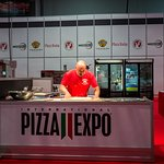 Dead serious moment where I'm teaching a crowd of pizzeria owners.