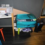 A 24 inch suitcase is the practical limit for this luggae shelf