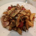Pork medallions with fried potatos and vegetables